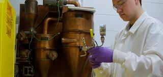 A researcher performing the AFEX pretreatment method